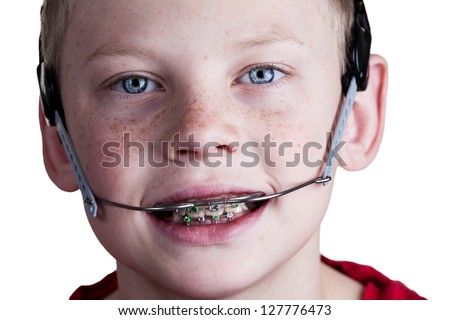 Boy with braces and headgear