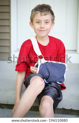 Boy with broken arm  - stock photo