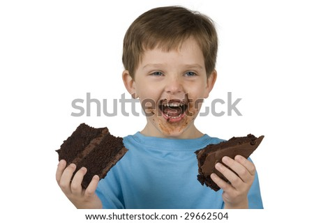 Boy with cake makes a mess while eating - stock photo