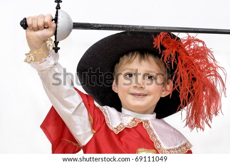 Boy with carnival costume . Little fighting musketeer. - stock photo