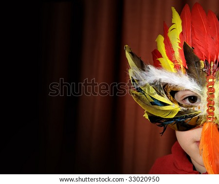 Boy with carnival mask - stock photo