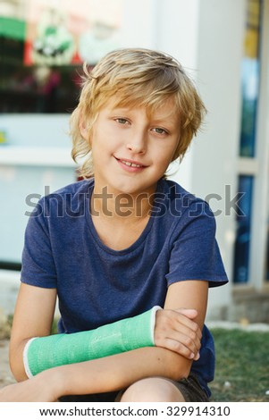 boy with cast on the right hand - stock photo