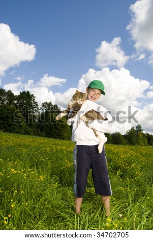 Boy with cat in hands