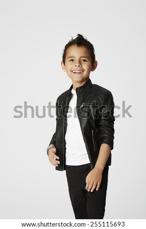 Boy with cheeky smile in leather jacket