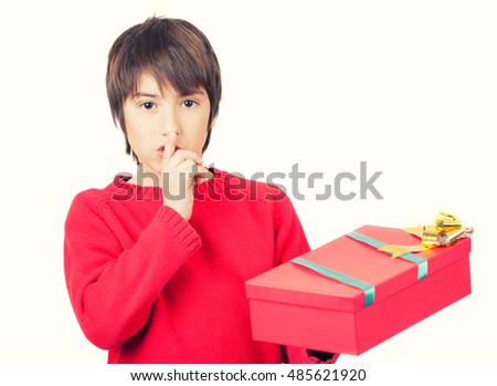 Boy with Christmas gift ready for a surprise. Isolated on white.