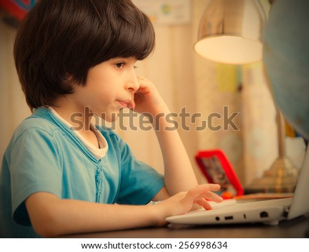 boy with computer, distance learning. instagram image retro style - stock photo