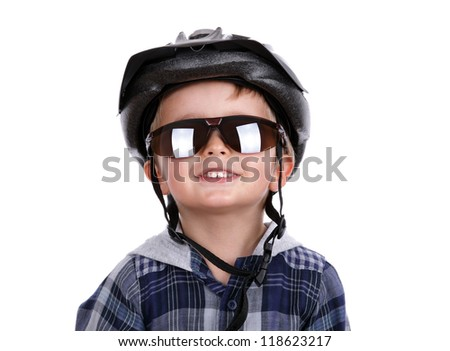 Boy with cycling helmet and dark sunglasses concept for child safety