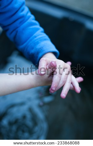 Boy with dirty hands - stock photo