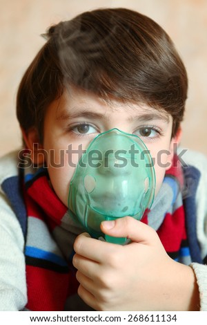 boy with electric inhaler as a curation against virul disease flue - stock photo