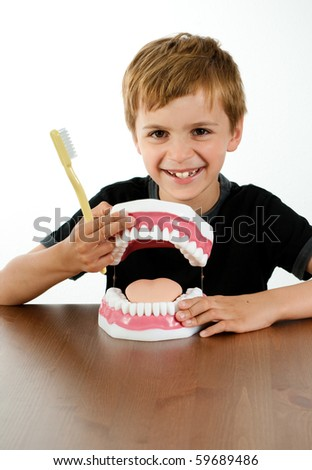 Boy with Fake Jaw and Tooth Brush at Dental Office - stock photo