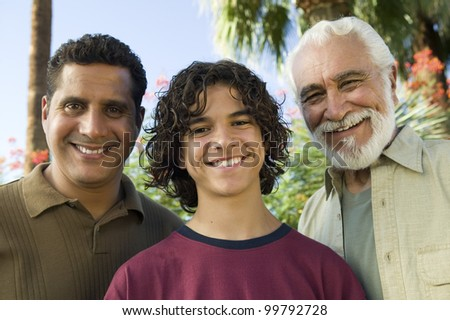 Boy with Father and Grandfather - stock photo