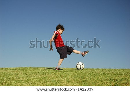 Boy with football - stock photo