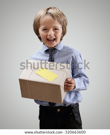 Boy with gift or delivery guy with brown wrapped package - stock photo