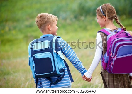 Boy with girl walking to school