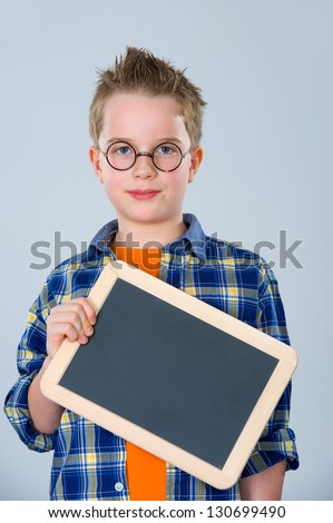 boy with glasses and little blackboard - stock photo