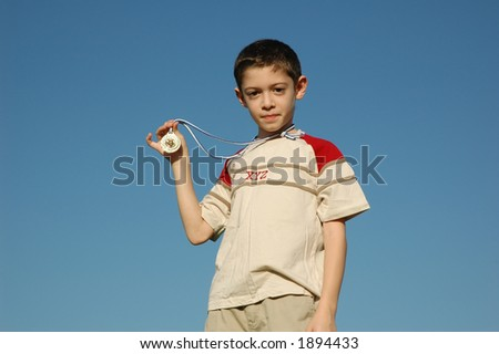 Boy with gold medal