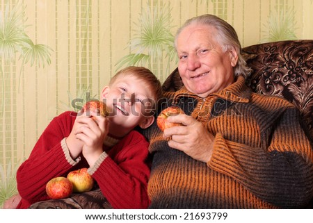 boy with grandfather eating apple