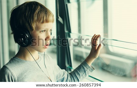 boy with headphones - stock photo