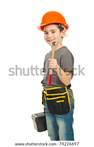 Boy with helmet holding hammer and tools box isolated on white background - stock photo