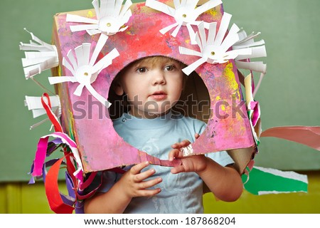 Boy with his DIY costume for carnvial in a kindergarten - stock photo