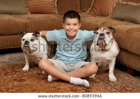 Boy with his pet dogs