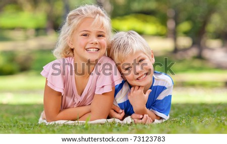 Boy with his sister in the park - stock photo