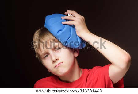 Boy with ice pack on his head