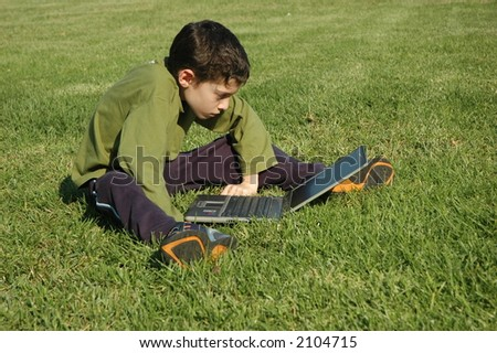 Boy with laptop - stock photo