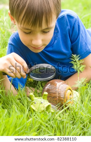 boy with loupe looking at a helix