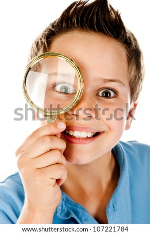 boy with magnifier on a white background - stock photo