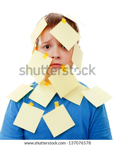 boy with memo posts on his face  on a white background - stock photo