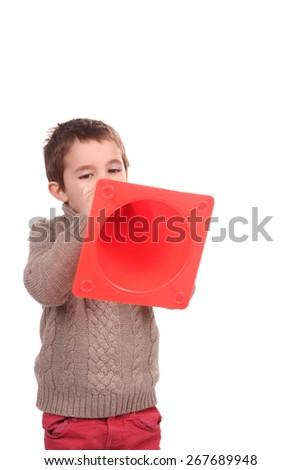 boy with orange traffic  cone - stock photo