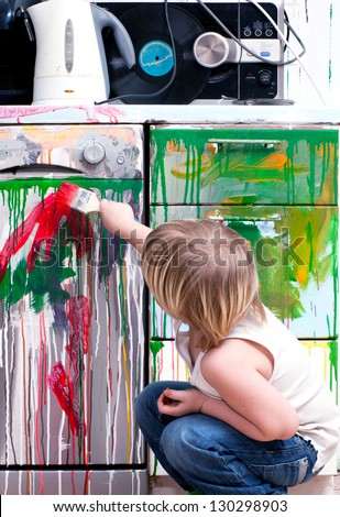 Boy with paint on a white background