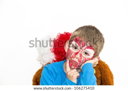 Boy with painted face. Sport supporter.