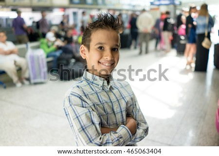 Boy with people in background