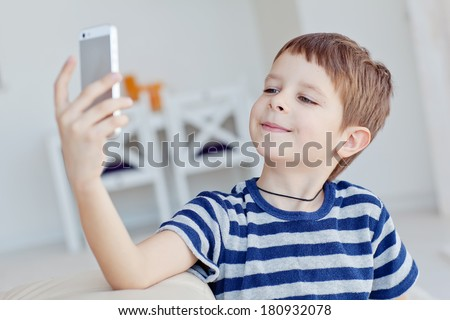 Boy with phone - stock photo