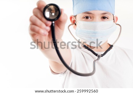 Boy with phonendoscope - stock photo