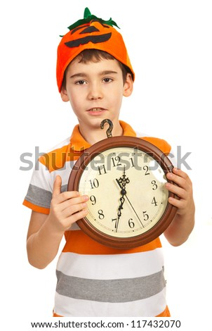 Boy with pumpkin hat holdink clock  isolated on white background - stock photo