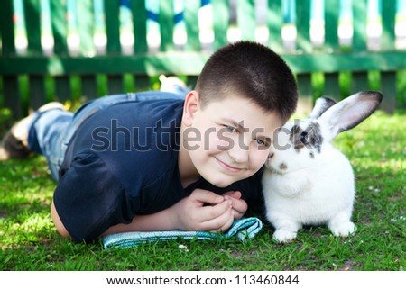 boy with rabbit - stock photo