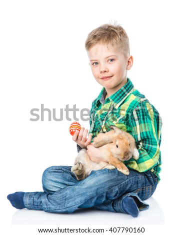 Boy with rabbit and easter egg. Isolated on white background