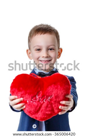Boy with red symbolic heart, on white background.