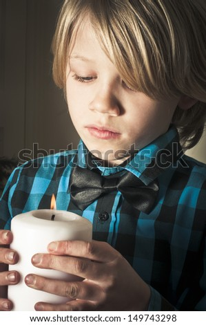 Boy with religious candle