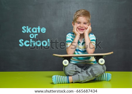 Boy with skateboard in front of school board with text  SKATE OR SCHOOL