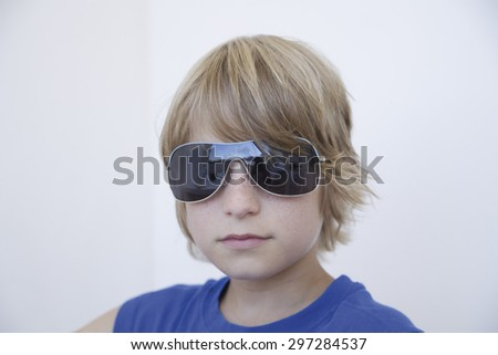 Boy with sunglasses,close up