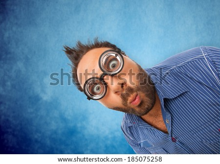 Boy with surprised expression and eye glasses on white background - stock photo