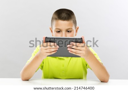 Boy with tablet computer - stock photo