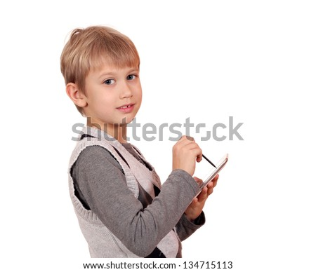 boy with tablet pc posing on white