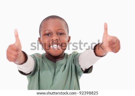 Boy with the thumbs up against a white background - stock photo
