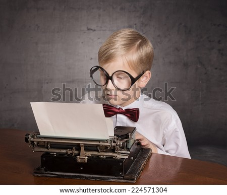 Boy with the typewriter. Retro style portrait - stock photo