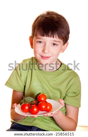 boy with tomatoes isolated on white - stock photo